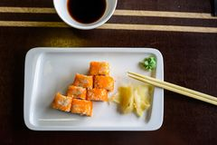 Top view Japanese rolls with ginger and chopsticks stock image