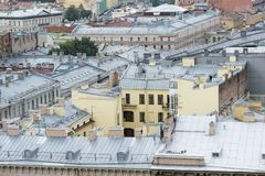 Top view of the restored old part of the city with modern metal roofs stock photo