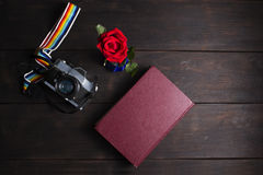 Top view  retro camera and  memory note book  on wood background Stock Photography