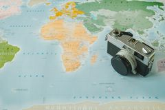 Top view. retro camera placed on top of world map are background. Top view. retro camera placed on top of color world map are background. this image for stock photography