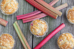 Top View on Rhubarb muffins with rhubarb petioles in the backgro Stock Image