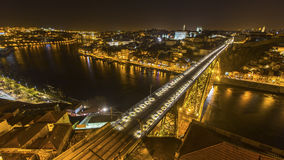 Top view of Ribeira and Douro river at night time in Porto Stock Photography
