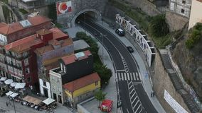 Top View of Ribeira, road and tunnel from Dom Luis I Bridge in historic center of Porto. stock video
