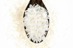 Top view Rice grain in wooden spoon Royalty Free Stock Images