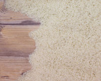 Top view of rice on wooden board Royalty Free Stock Photos