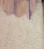 Top view of rice on wooden board Royalty Free Stock Images