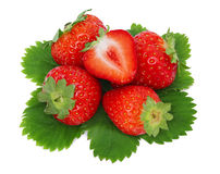 Top view of ripe strawberries pile with green leaves (isolated) Stock Photo