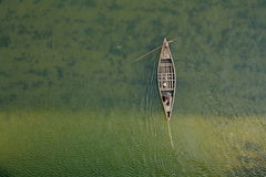 Top view of river boat from bridge green water. Royalty Free Stock Photography
