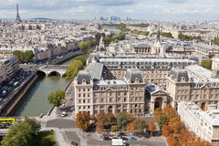 Top view river Seine, downtown, tower Eiffel. Top view from cathedral Notre Dame on river Seine, bridge Saint Michel and Neuf, roofs, housetops, streets, center Royalty Free Stock Images