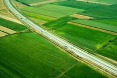 Top view, road and cars in fields Royalty Free Stock Images