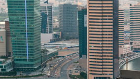 Top view of road in Dubai downtown timelapse with day traffic and business bay skyscrapers. Top view of road in Dubai downtown timelapse with day traffic before stock footage