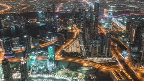 Top view of road in Dubai downtown timelapse with night traffic and illuminated skyscrapers. 4K Timelapse in Dubai, United Arab Emirates stock video footage