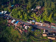 Top view of the road passing through the village and rice fields.  Stock Photos