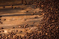 top view of roasted coffee beans spilled on rustic royalty free stock images