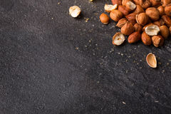 Top view of roasted peeled hazelnuts on a saturated black background. Savory bright snacks. Copy space. Stock Images