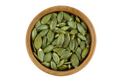 Top view of roasted pumpkin seeds in wooden bowl. Dry Pepita aft stock photo