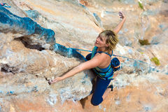 Top View of Rock Climber on orange Vertical Wall Royalty Free Stock Image