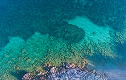 Top view of rock formations and the bottom of the sea seen through the clear water.  stock photo