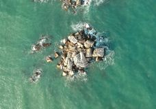 Top View of Rock Formations Surrounded by Water stock photography