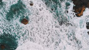 Top view of the rocks in the water, giant waves hit the coast. Benijo Beach, Tenerife, Canary Islands, Spain stock video