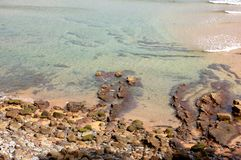 Top view of the rocky beach. A top view of a rocky beach during the summer, located in Asturias, Spain royalty free stock photos