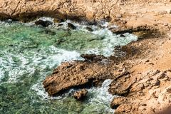 Top view of a rocky coast with a coral reef in the Red sea Royalty Free Stock Image