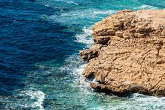 Top view of a rocky coast with a coral reef in the Red sea Stock Images