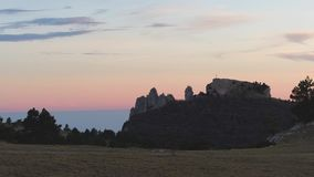Top view of rocky pillars. Shot. Panoramic view of rock formations. Scenery is beautiful colorful light of sunset