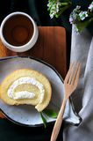 Top view of Roll Cake and Hot Tea. Serve on wooden board royalty free stock photography