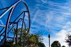 Top view of rollercoaster and Sky Tower with USA Flag at Seaworld in International Drive area . stock image