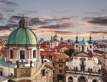 Top view of the roofs of Prague, with red tiled roofs and statues, spires and towers protruding, Czech Republic. Top view of the roofs of Prague, with red tiled Royalty Free Stock Images