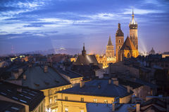 Top view of the rooftops of the old town of Krakow at night. Travel. Royalty Free Stock Photo