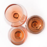 Top view of rose wine glasses. Top view of three rose wine glasses of different shapes and sizes isolated on white background Stock Photography