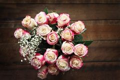 Top View of Roses. Top view of a beautiful bouquet of a dozen red and white roses with baby`s breath shot from above. Selective focus on top of roses with Stock Photos