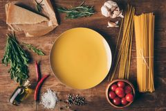 top view of row pasta, fresh ingredients and plate stock images
