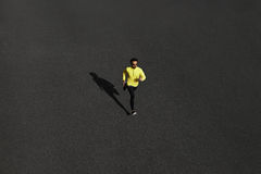 Top view runner man running sprinting for success on run at blac Stock Photo