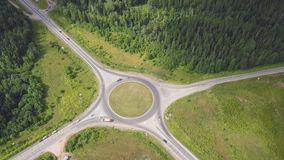 Top view of rural roundabout. Clip. Traffic on roundabout rural road in wooded area.  stock photography