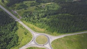 Top view of rural roundabout. Clip. Traffic on roundabout rural road in wooded area.  royalty free stock images