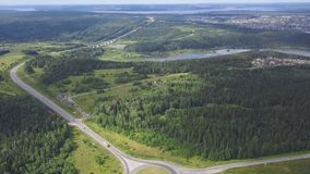Top view of rural roundabout. Clip. Traffic on roundabout rural road in wooded area.  stock images