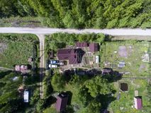Aerial view at Russian summer cottage with house, garden, barns and sauna at summer, Russia Royalty Free Stock Photography
