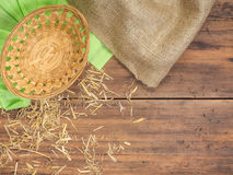 Top view, rustic background with a basket, colored green paper, burlap and straw, hay. Rural, eco background with place Stock Photos