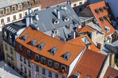Top view of rusty and red tile roofs, Riga, Latvia Royalty Free Stock Photo