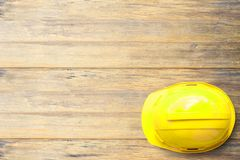Top view Safety Engineer Helmet on brown wooden table background Stock Images