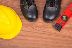Top view safety shoes and composition of working tools Stock Photos