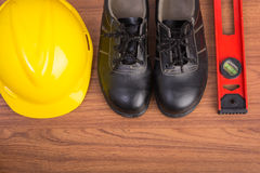 Top view safety shoes and composition of working tools Stock Photography
