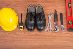 Top view safety shoes and composition of working tools Royalty Free Stock Image