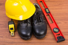 Top view safety shoes and composition of working tools Royalty Free Stock Photography