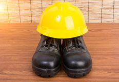 Top view safety shoes and composition of working tools Royalty Free Stock Images