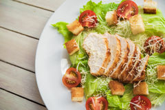 Top view of salad cesar with chiken. On white wood table Royalty Free Stock Photos