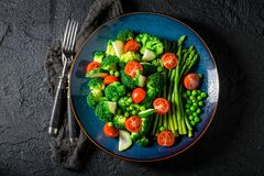 Top view of salad with cherry tomatoes, asparagus and broccoli Royalty Free Stock Image